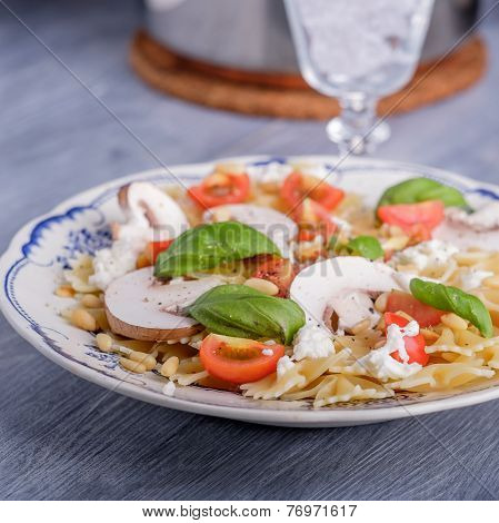 Pasta Salad With Tomatoes And Mushrooms And Some Basil