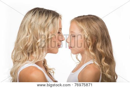 Beautiful blonde mother and her daughter together
