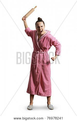 displeased screaming housewife holding rolling pin and looking at camera. isolated on white background