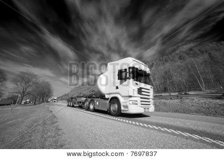 fuel truck under storm clouds