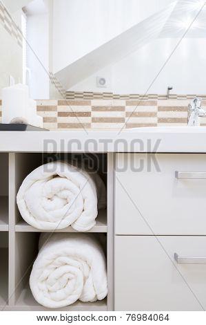 Towels In Modern Bathroom's Cupboard