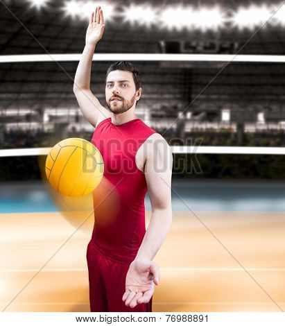 Volleyball player on red uniform on volleyball court.