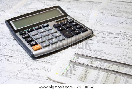 Calculator And Newspaper