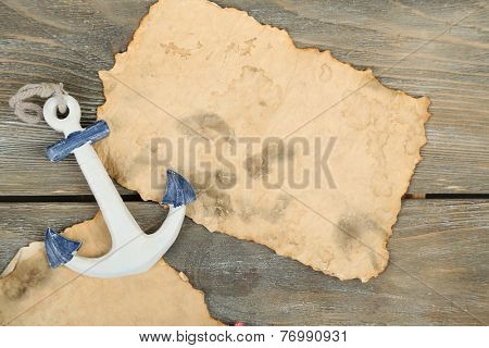 Decor of seashells, starfish and old paper on wooden table background