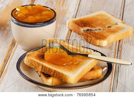 Slices Of Toast Bread On Wooden Background