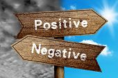 picture of positive negative  - Positive Or Negative concept road sign with cloudy and sunny sky background - JPG