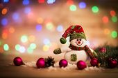 pic of snowman  - Christmas background with Christmas tree and snowman on a rustic wooden board - JPG