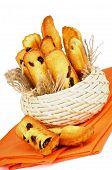 pic of baked raisin cookies  - Arrangement of Biscuit Raisin Cookies in Wicker Bowl on Orange Napkin closeup on White background - JPG