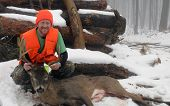 stock photo of ten  - Happy hunter portrait with a Wisconsin Whitetail trophy ten point buck