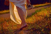 picture of girl walking away  - Girl walking along the park - JPG