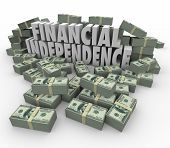 stock photo of revenue  - Financial Independence 3d words in piles of cash - JPG