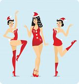 stock photo of cabaret  - Cabaret girls dancing  in Santa Claus costumes - JPG