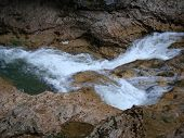 foto of rough-water  - rough stream of the foaming water in the gorge - JPG