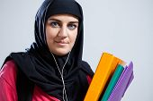 picture of middle eastern culture  - Middle Eastern female student holding documents - JPG