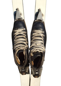 foto of ski boots  - Old ski boots in black with white laces isolated on white background - JPG