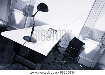 Simple study interior with a desk and anglepoise lamp in a white paneled room with herringbone parquet floor, angled view. 3d Rendering