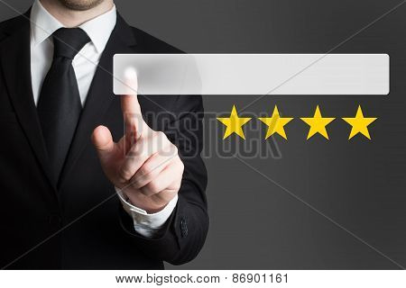 Businessman Pushing Button Four Golden Stars