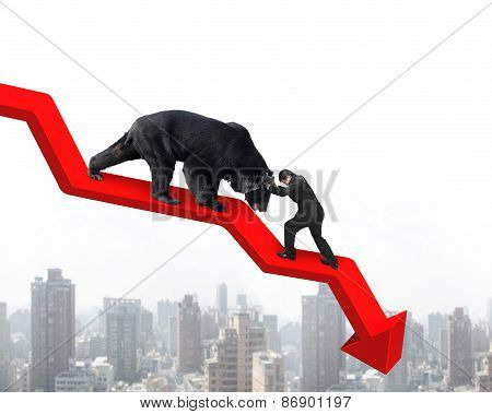 Businessman Against Bear On Arrow Downward Trend Line With Cityscape