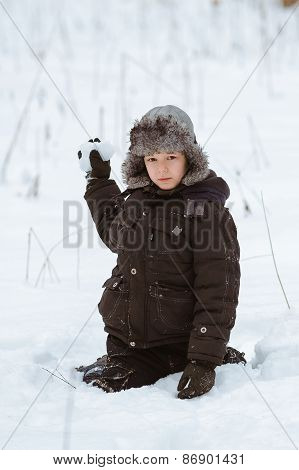 A Boy Plays In The Snow