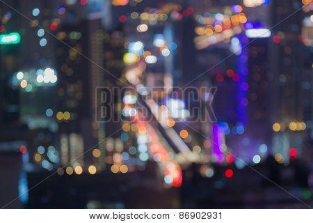 Defocused background of top sky train station night lights