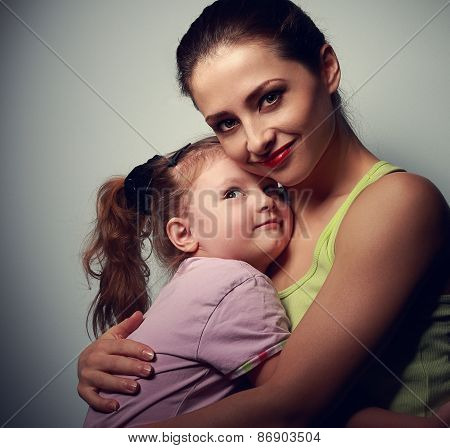 Happy Family. Mother Cuddling Daughter With Love