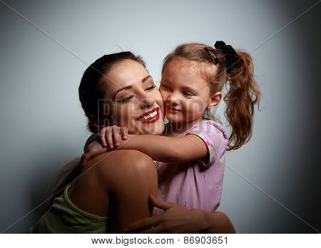Beautiful Smiling Young Mother Cuddling Her Cute Daughter