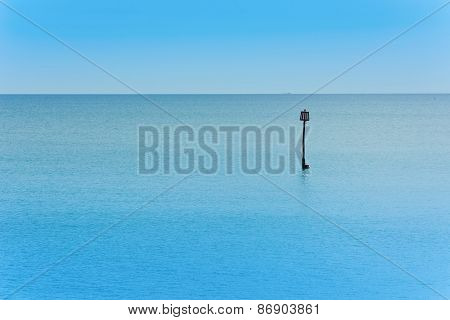 Sea View Over Calm Water With Blue Sky.