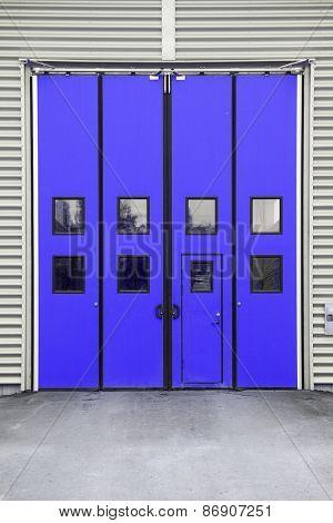 Blue Garage Door on a warehouse building