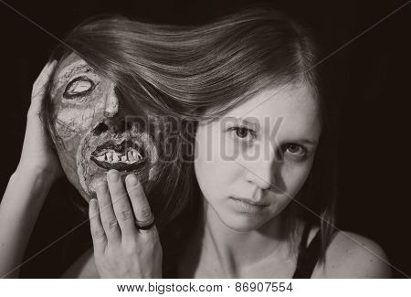 Portrait Of A Young Woman With Spooky Theatrical Mask