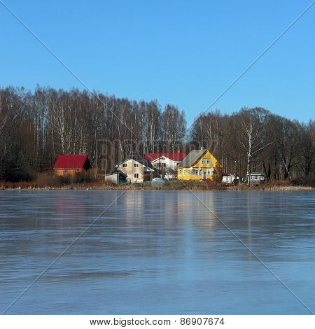 Houses On The Lake Covered With Ice
