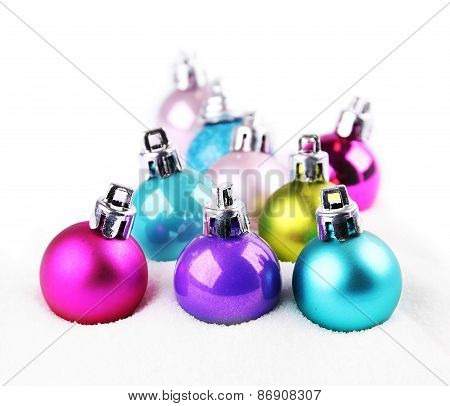 Colorful Christmas Balls In Snow