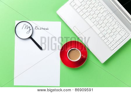 Loupe, Paper And Cappuccino With Computer