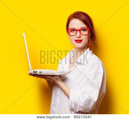 Happy Redhead Girl In White Shirt With Computer