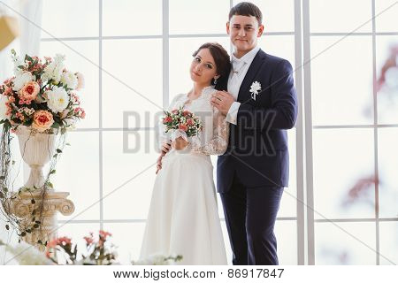 Happy Bride And Groom In  Studio