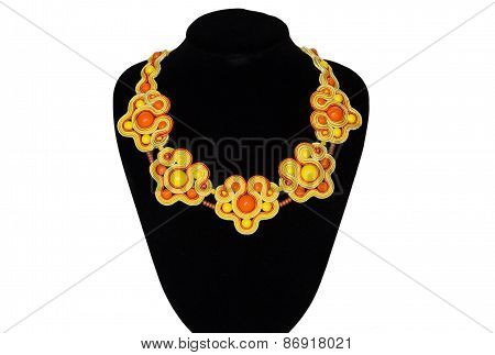 Yellow Necklace On A Rack