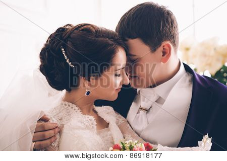 Portrait Of Caucasian Groom And Bride Embracing