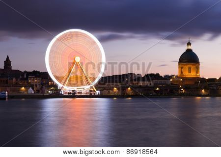 Spinning Ferris Wheel And The Chapelle At Night In Toulouse