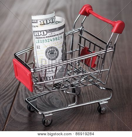 a hundred dollars in the shopping trolley