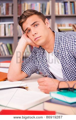 Tired Student In Library.