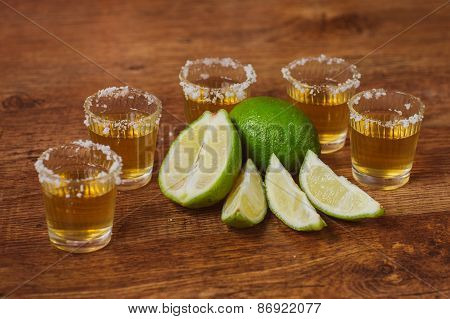 Tequila , Lime And Salt On Wooden Table