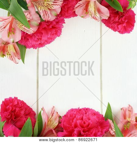 Double flower border on white wood