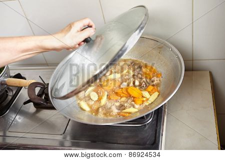 Stir frying cap cai or mixed vegetable, chinese cuisine in Indonesia