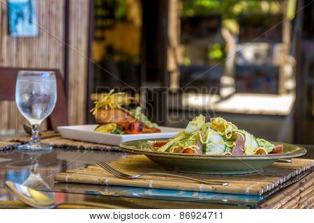 fresh salad with eggs and vegetables served in a small outdoor restaurant, meal time