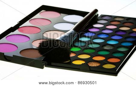 multicolored eye shadows with cosmetics brush