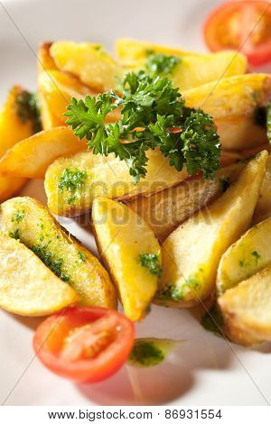 Deep Fried Potato Slice Garnished with Cherry Tomato and Parsley