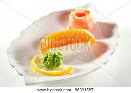 Japanese Cuisine -  Salmon Nigiri Sushi with Ginger and Wasabi