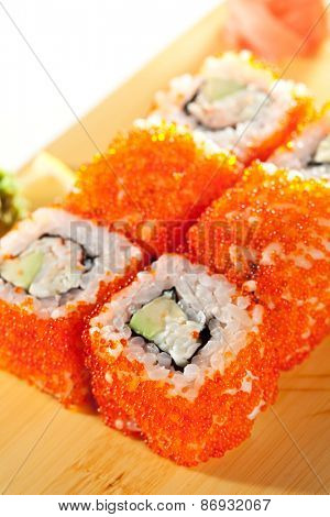 California Maki Sushi with Tobiko  - Roll made of Fresh Raw Salmon, Avocado, Japanese Mayonnaise inside and Tobiko outside