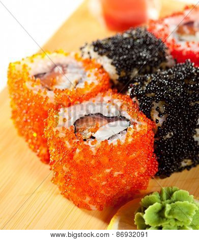 Japanese Cuisine - Sushi Roll with Tuna, Salmon, Eel and Shrimp inside. Tobiko outside