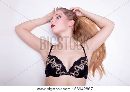 Gorgeous Blonde In Bra Lying On Grey Background