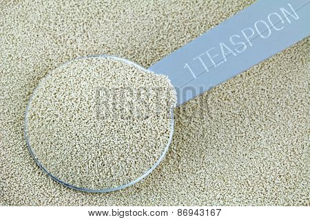 Closeup of a spoonful of active dry Baking yeast granules
